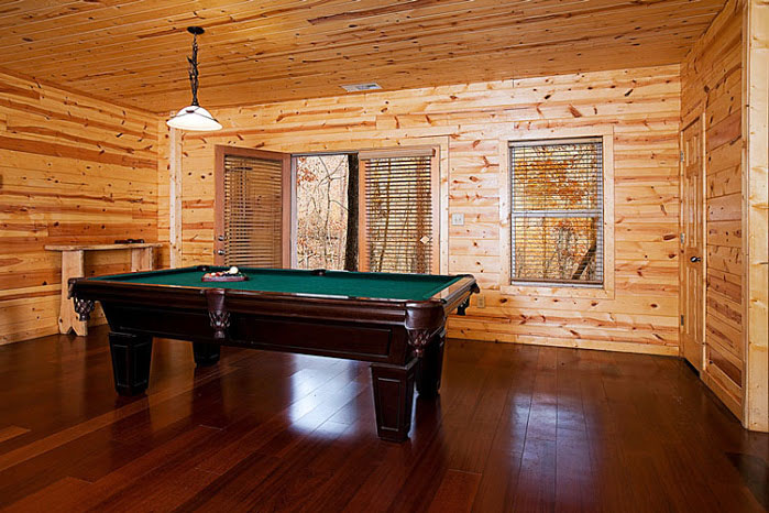 Pool Table w/ Waterfall in Backdrop.